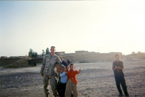 american soldier in iraq with kids