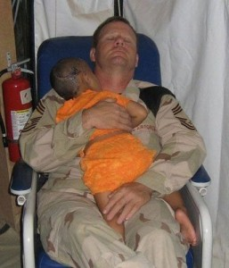 soldier comferts baby