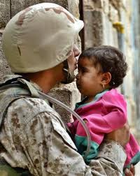 soldier kisses baby