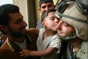 child kisses us soldier