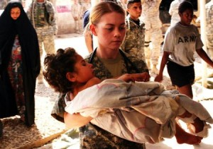 us soldier nurse carries wounded iraqi child